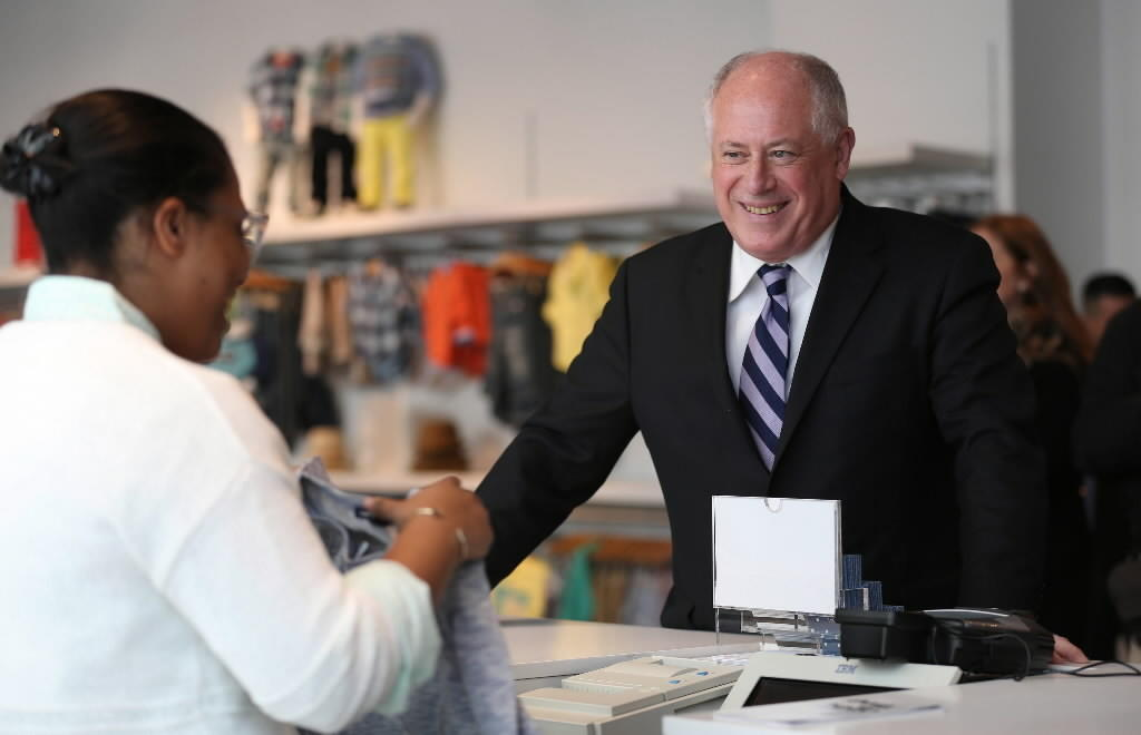 Gov. Pat Quinn is helped by Gap's Liv Jordan, while shopping for nieces and nephews on State Street.