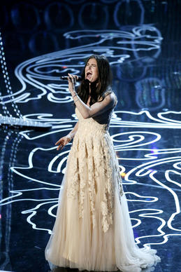 "Idina Menzel performs ""Let It Go"" during the 86th Academy Awards. When Oscar presenter John Travolta mangled Menzel's name before her performance, her renaming became a joke worldwide. 