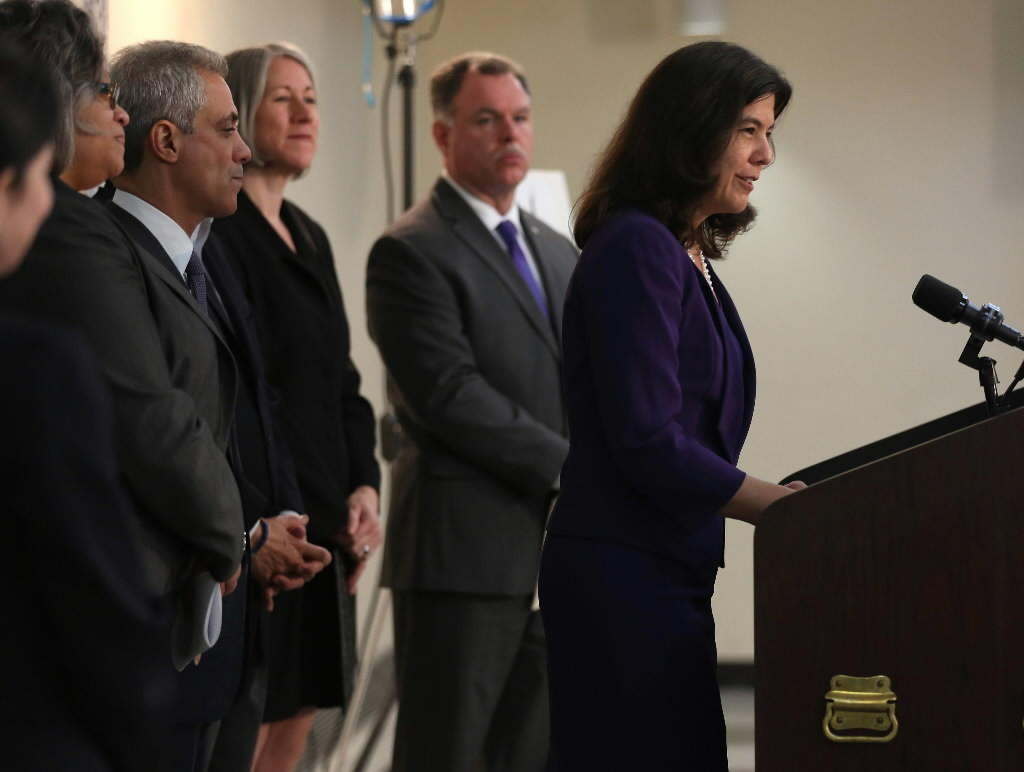 Mayor Rahm Emanuel, left, Chicago police Superintendent Garry McCarthy, center, listen to Cook County State's Attorney Anita Alvarez as she talks about a new inter-governmental domestic violence task force pilot program.