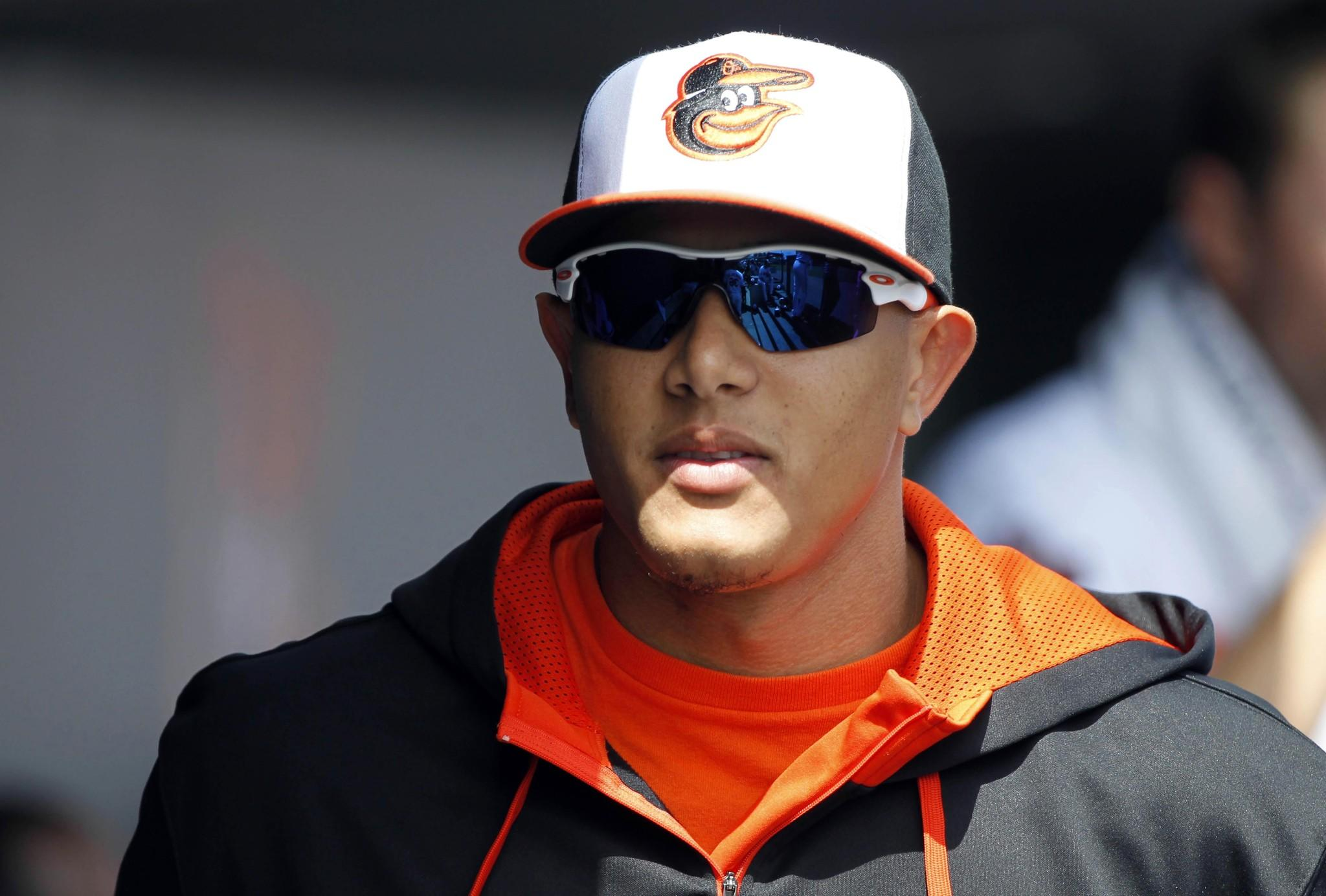 Orioles third baseman Manny Machado in the dugout against the New York Yankees at Ed Smith Stadium.
