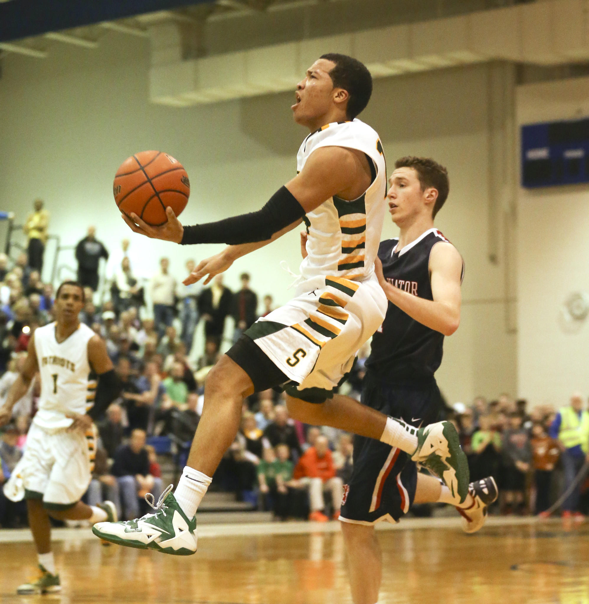 Stevenson's Jalen Brunson goes to the basket against St. Viator on Tuesday, March 11, 2014.
