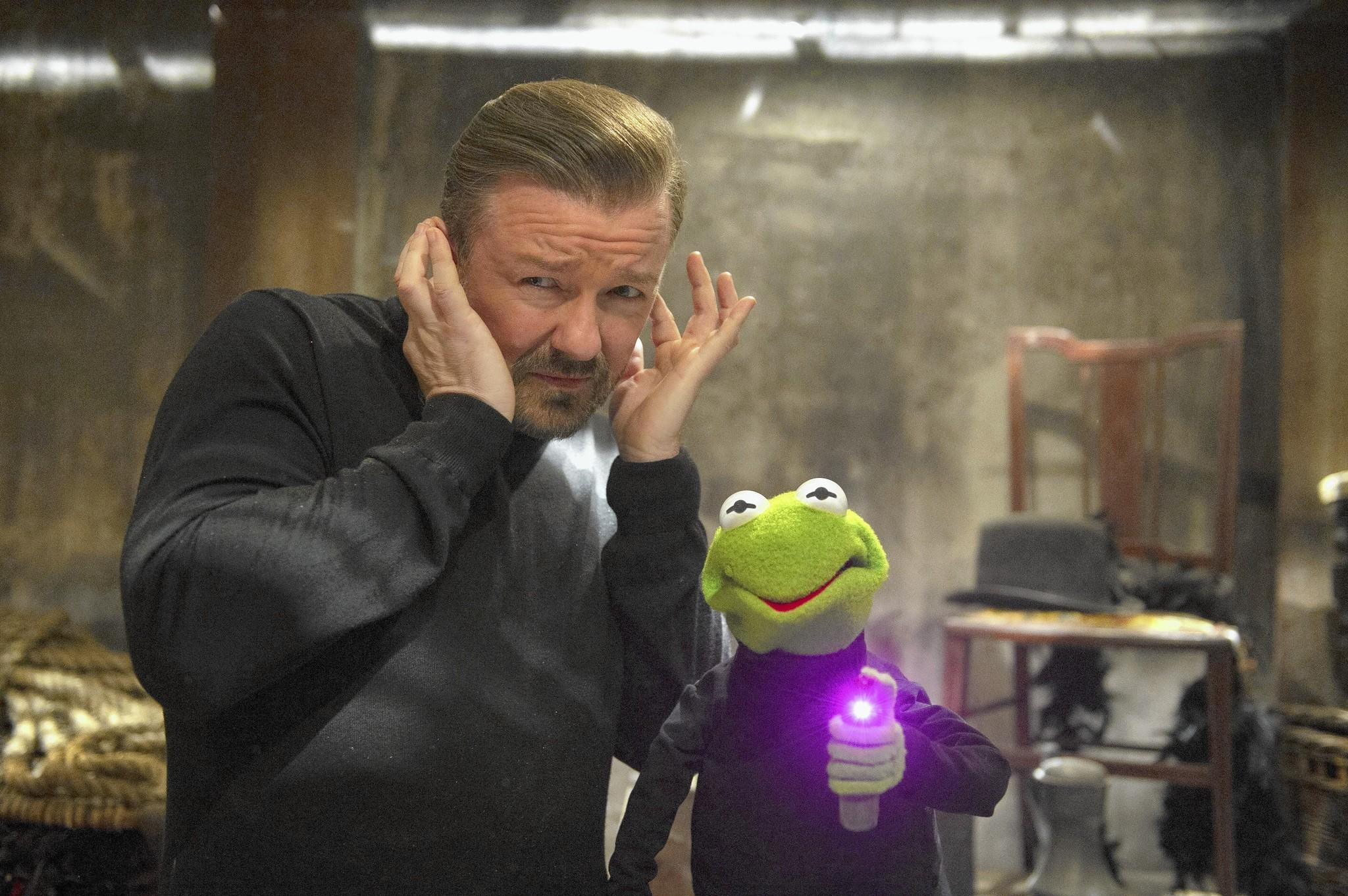 """Ricky Gervais with Kermit imposter Constantine in """"Muppets Most Wanted."""""""