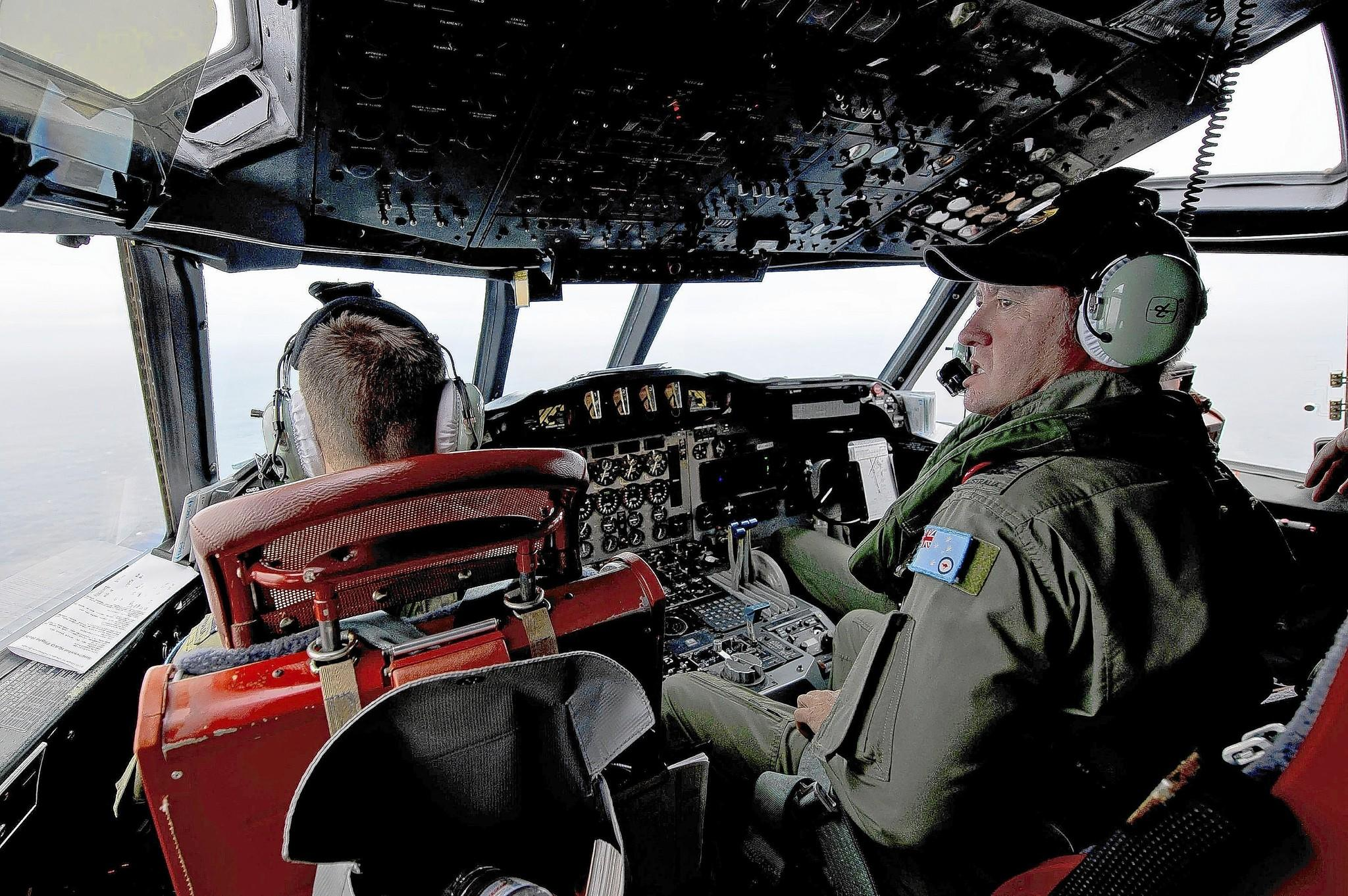 Members of Australia's air force look for debris from Malaysia Airlines Flight 370 in the southern Indian Ocean.