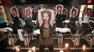 In-Your-Face Fitness: SoulCycle's mix of cycling and upper-body workouts raises concerns