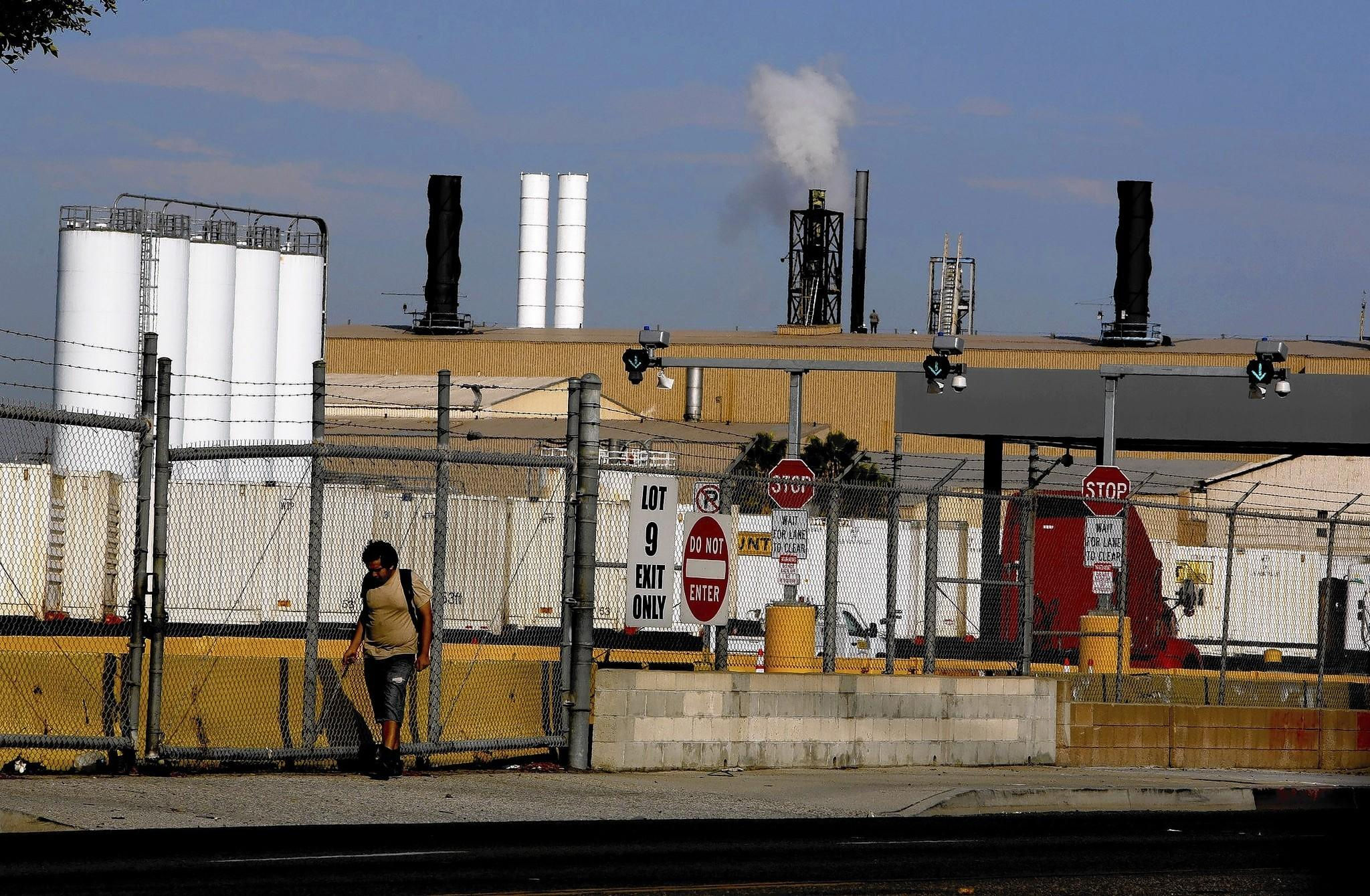 One year after the South Coast Air Quality Management District found that arsenic emissions from the Exide plant posed a cancer risk to more than 100,000 people, the agency has approved the company's plan to reduce health risks.