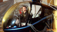 Up in the sky: Not a bird or a plane — a helicopter with ads