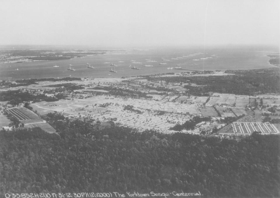 This 1931 aerial view shows the great expanse of military tents and fleet of American warships that assembled to mark the 150th anniversary of the American and French victory over the British at Yorktown.