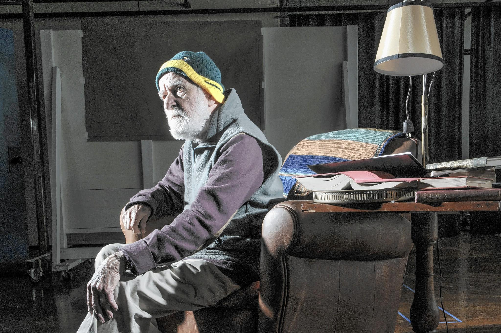 "South African playwright Athol Fugard takes a break in rehearsals for ""The Shadow of the Hummingbird"" at Long Wharf Theatre."