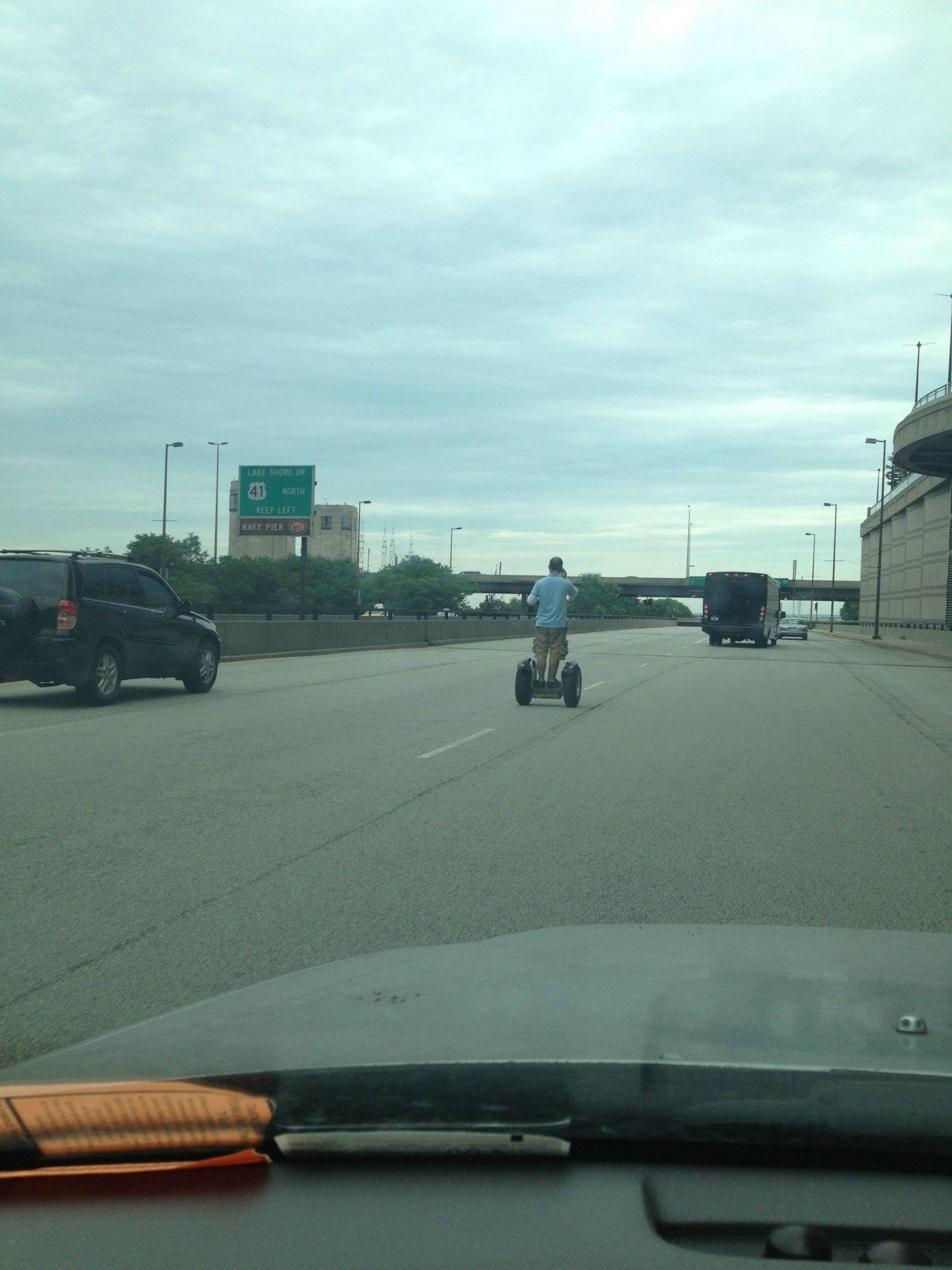 Taken last June, an oblivious Segway rider takes Lake Shore Drive.