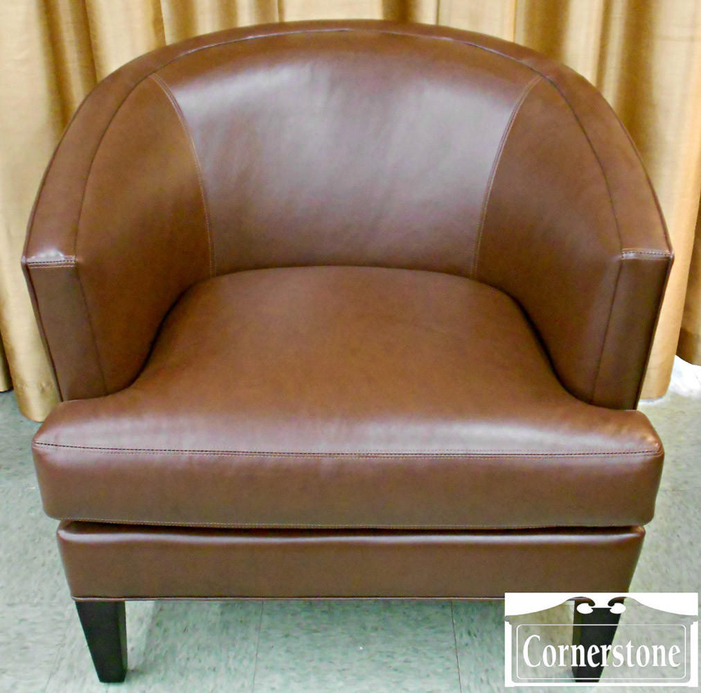 "Cornerstone Antiques has this Younger Furniture Contemporary Brown Leather Occasional Chair from the set of ""House of Cards"" for sale at $475."