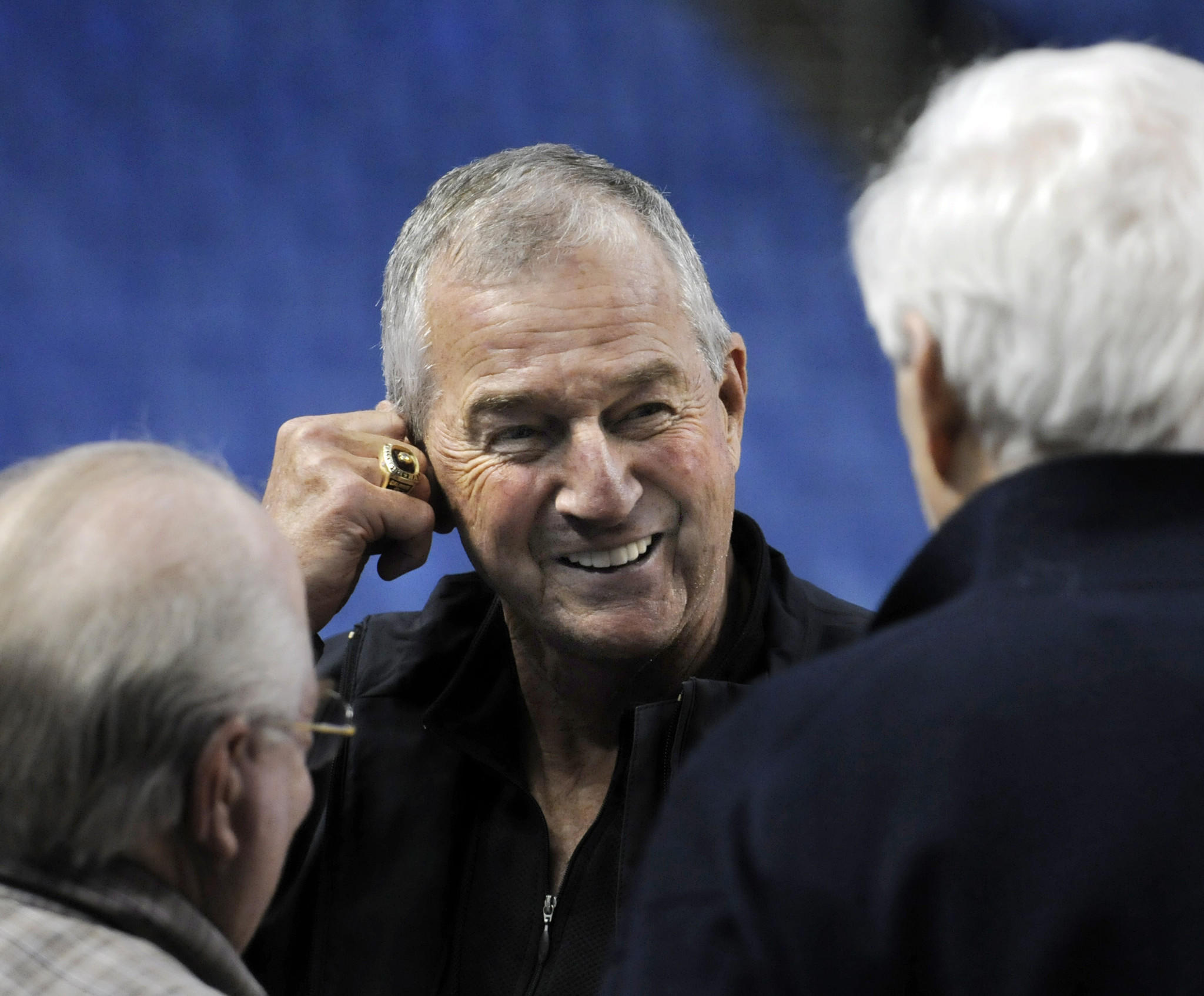 Former UConn head coach Jim Calhoun chats with TV broadcasters Bill Raftery, left, and Verne Lundquist, right, during practice on Wednesday.