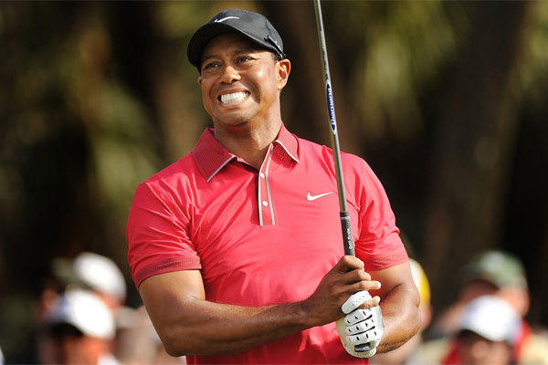 Tiger Woods grimaces as he follows through on his tee shot on the 12th hole during the final round of the WGC-Cadillac Championship at Trump National Doral on March 9, 2014, in Doral, Fla.