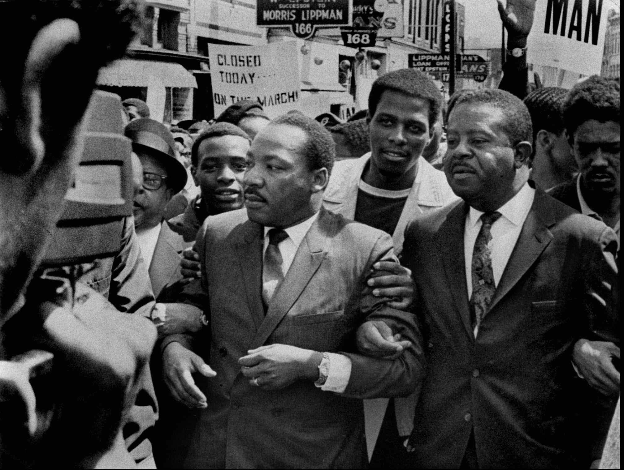 Dr. Martin Luther King Jr. and Rev. Ralph Abernathy, right, lead a march on behalf of striking Memphis sanitation workers on March 28, 1968. The dignity of the march soon gave way to disorder as a group of about 200 youths began breaking windows and looting. King, who agonized over what had happened, was killed within the week.