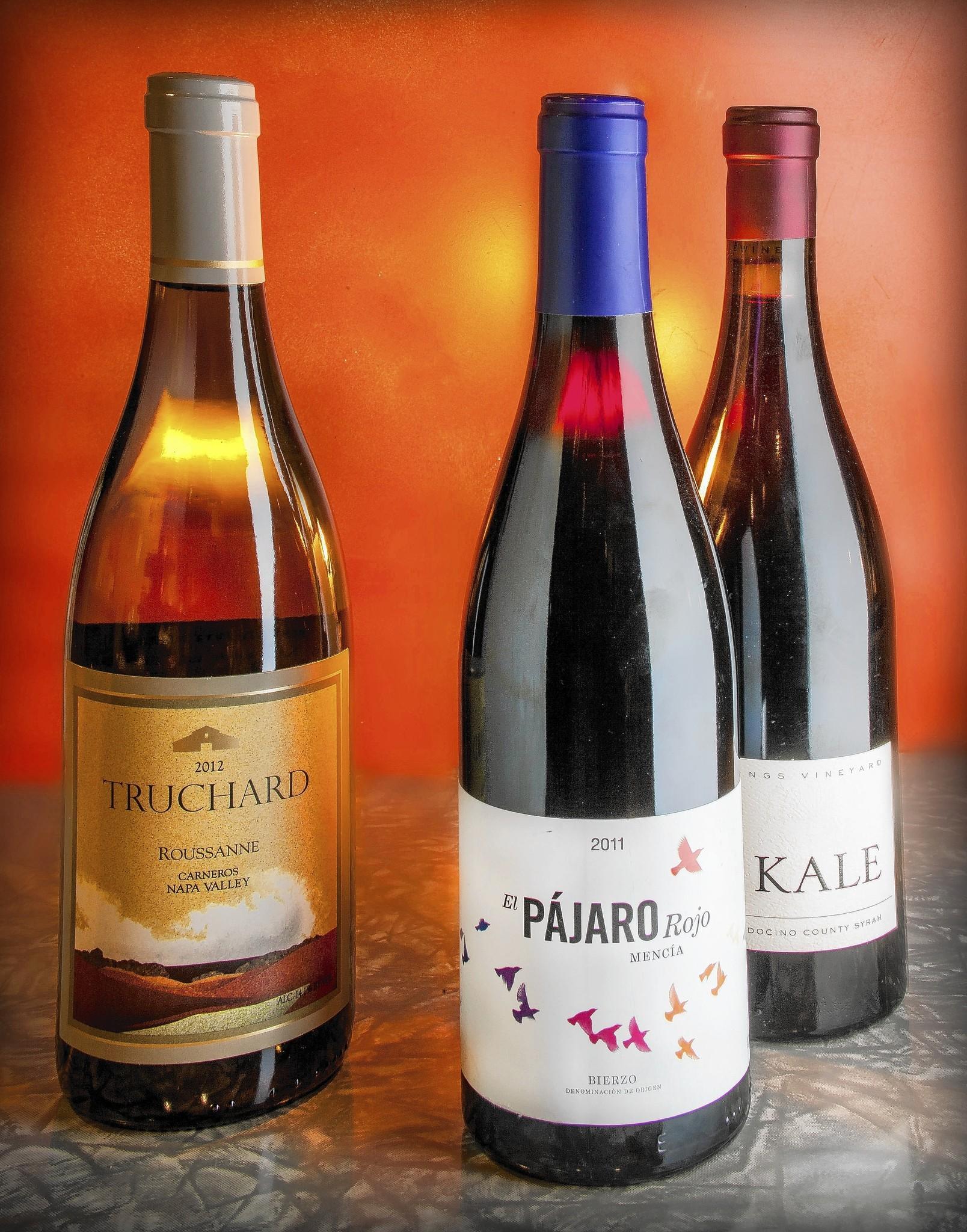 Three bottles of wine, Truchard, El Pajaro Rojo, and Kale.