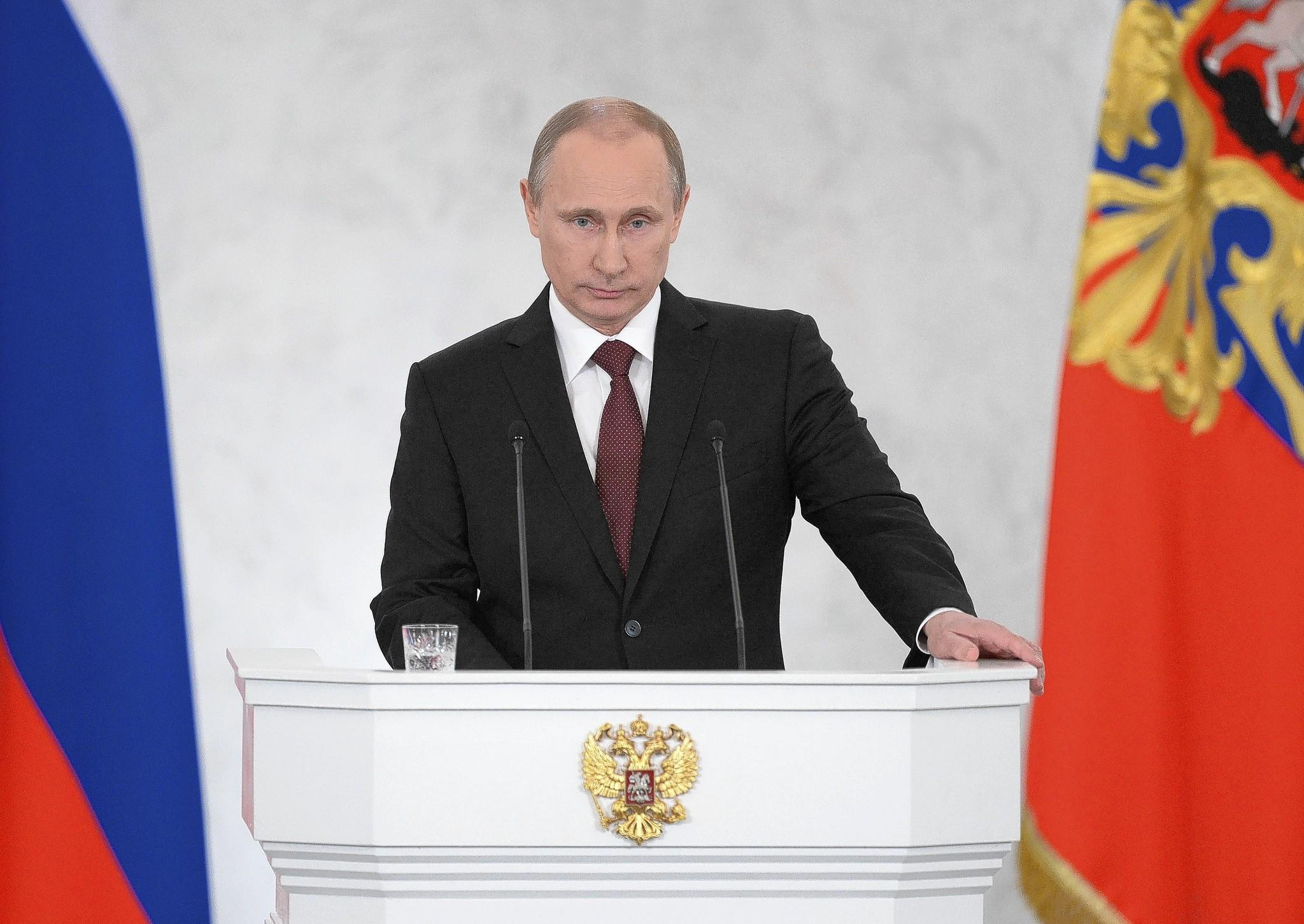 Vladimir Putin arrives to address a joint session of Russian parliament on Crimea in the Kremlin in Moscow on March 18.