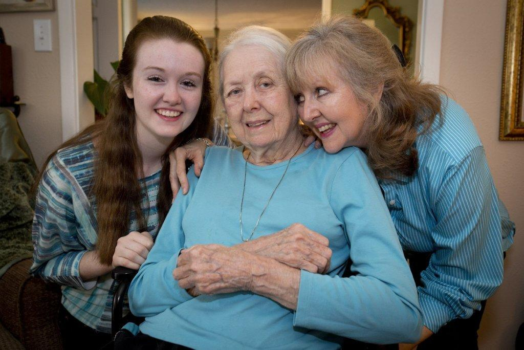 Bobbie Wilburn, 79, who has Alzheimer's disease, lives with her daughter Barrie Page Hill, right, and family. At left is her granddaughter, Brenna Hill.