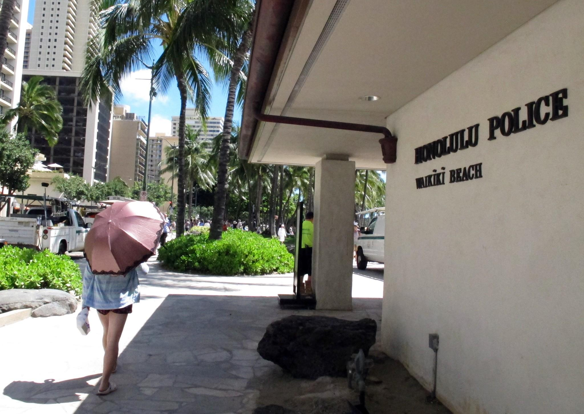 The Honolulu Police Department argued that if undercover police are no longer allowed to have sex with prostitutes, then prostitutes would be able to change their tactics and filter out officers. Above, a pedestrian in front of a Honolulu police station.
