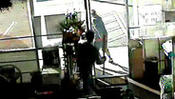 Surveillance video: Liquor store owner fights against armed robber