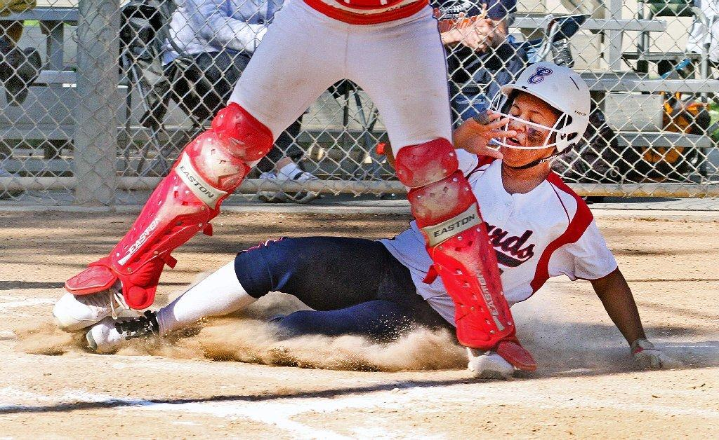 Bell-Jeff's Tiffany Galindo slides home safely during the Guards' nonleague loss to Chaminade on Friday.