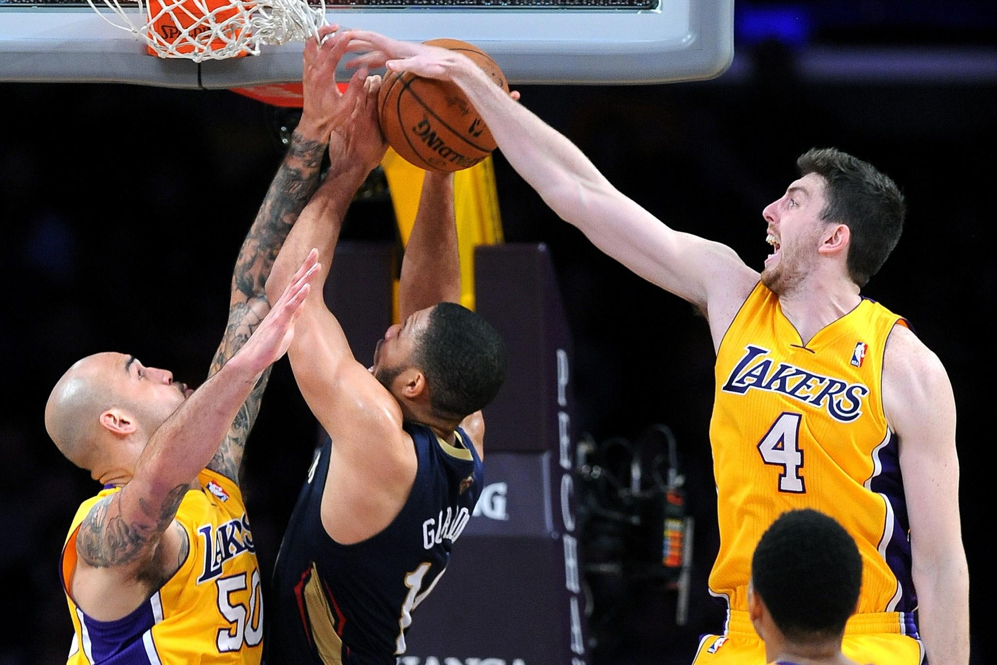 Ryan Kelly, right, gets a hand on New Orleans Pelicans guard Eric Gordon's shot during a game March 4 at Staples Center.
