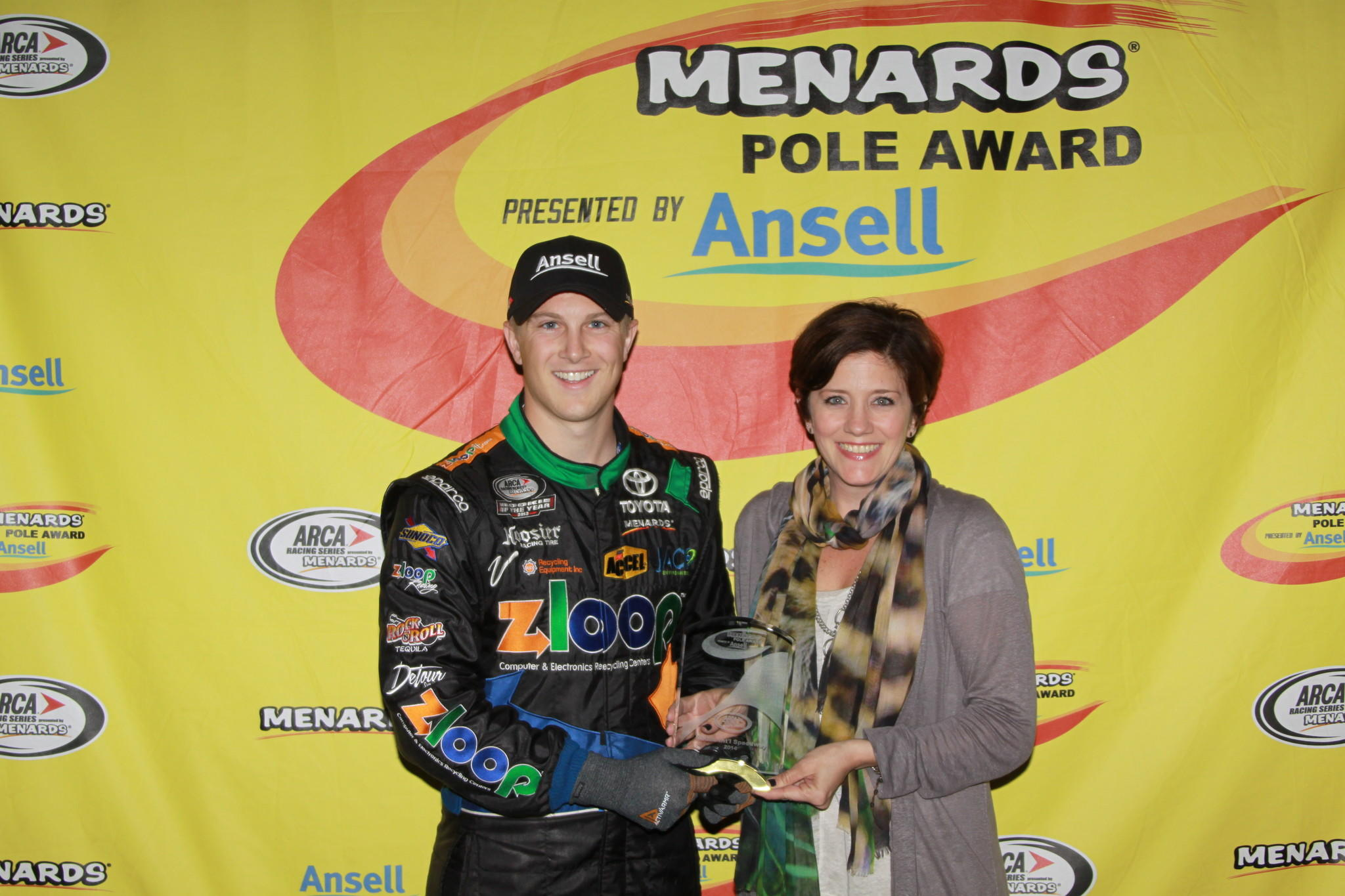 Justin Boston is pictured with Kerry Allen, territory manager with Ansell, after his third career Menards Pole Award presented by Ansell.