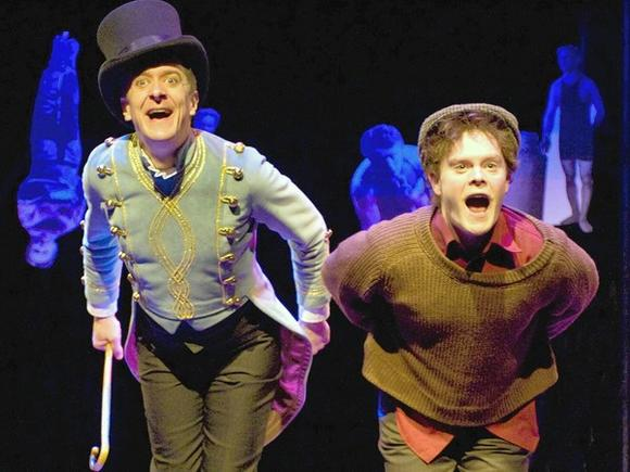 "The Barker (Derek Hasenstab) and Victor (Alex Weisman) in Chicago Children's Theatre's  family musical ""The Houdini Box."""