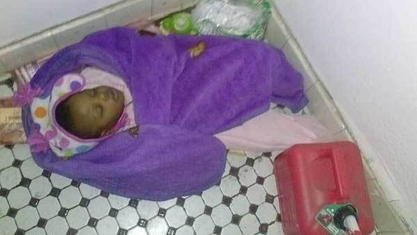 A photo of the 1-year-old girl where she was found Friday in the vestibule of a South Side apartment building.
