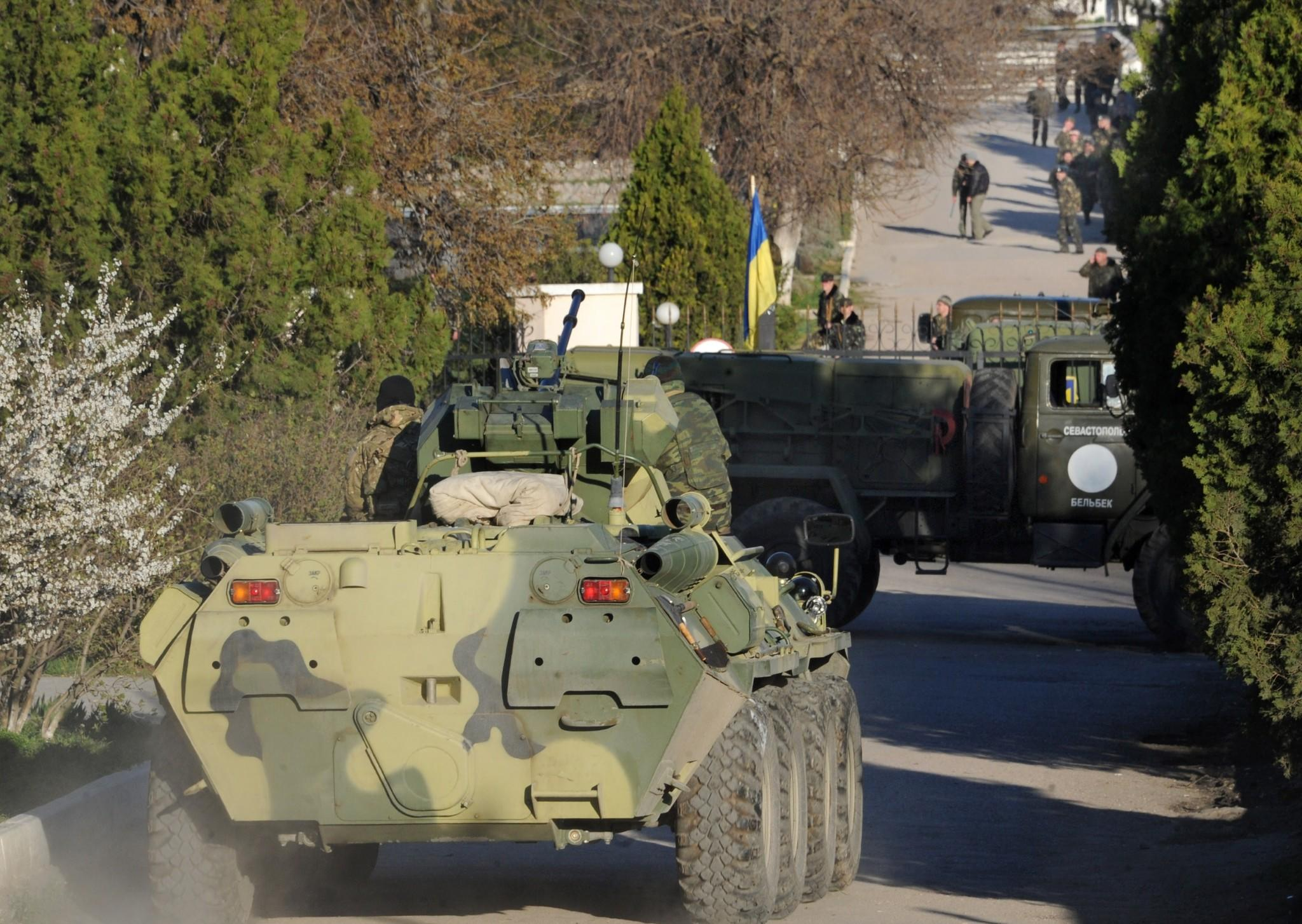 Russian tanks and soldiers storm a Ukrainian air force base in Belbek near the Crimean city of Sevastopol on Saturday.