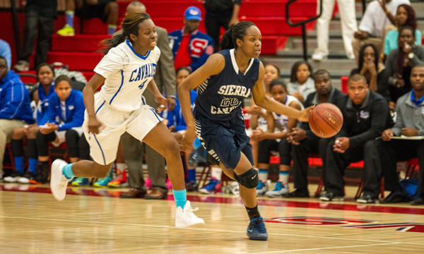 Sierra Canyon's Kennedy Burke, right, dribbles past Gardena Serra's Nautica Morrow in Saturday's Southern California Regional Division IV final at Colony High. Sierra Canyon won, 59-52.