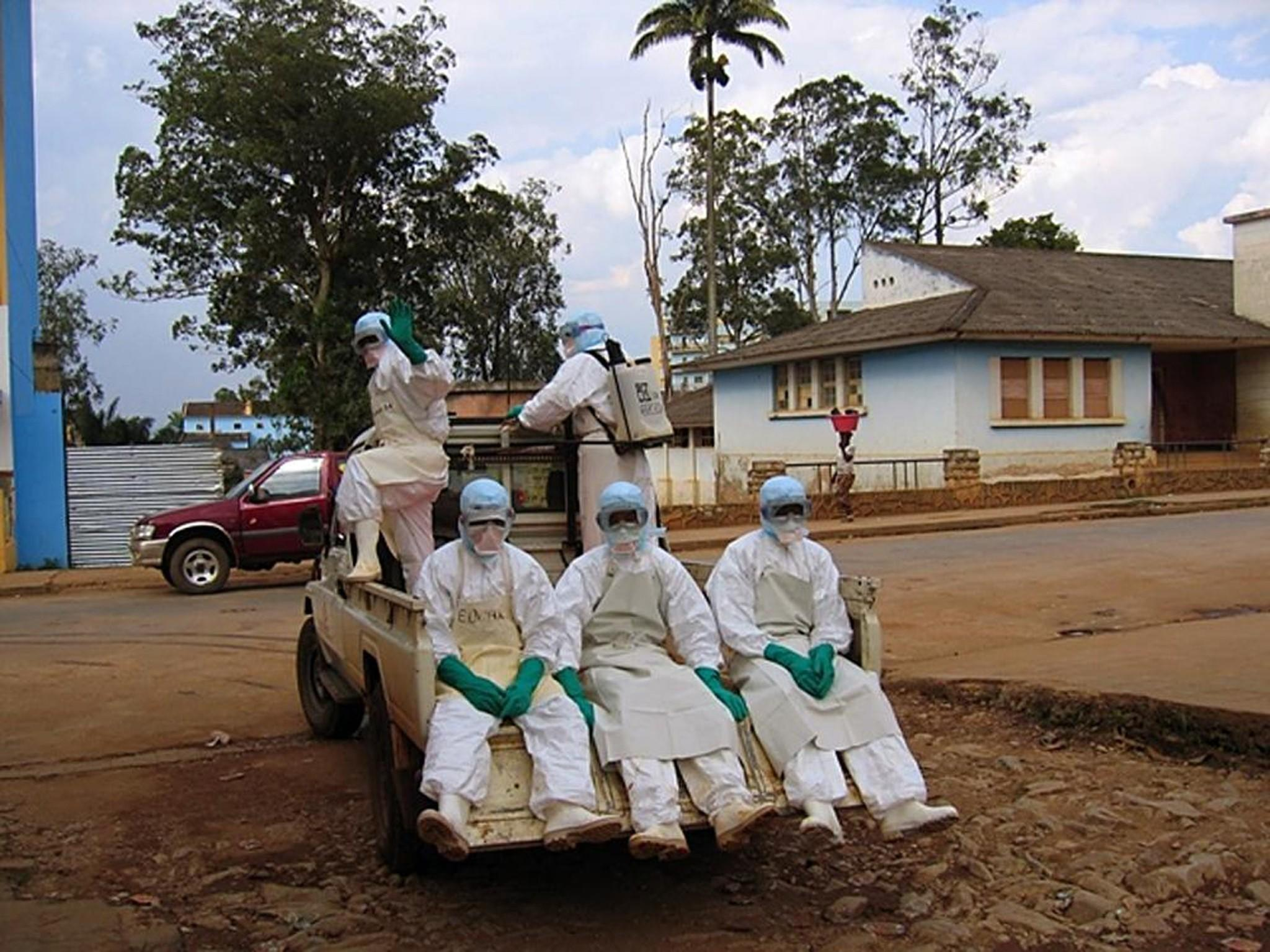 "This picture taken on April 9, 2005 shows five health workers, dressed in head-to-toe ""Ebola suits."" The Ebola virus has been identified as the source of an outbreak of hemorrhagic fever in southern Guinea, the west African nation said."
