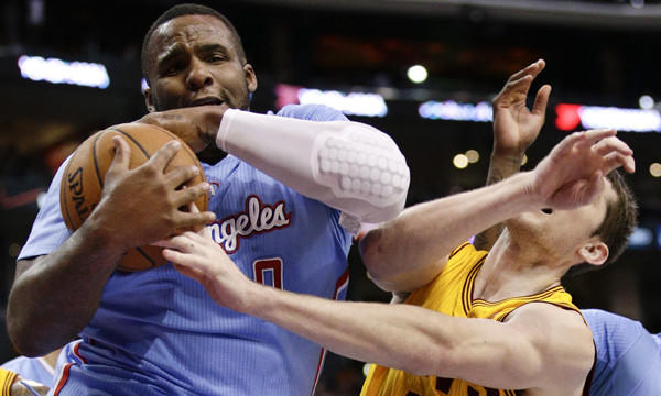 Clippers power forward Glen Davis, left, battles Cleveland Cavaliers center Tyler Zeller for a rebound during a March 16 game. Davis says he's still in the process of getting to know his Clippers teammates.