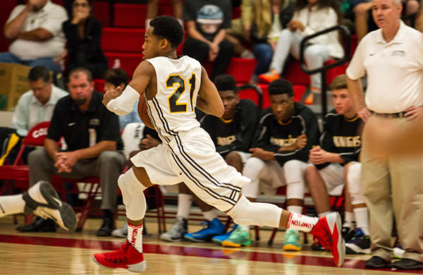 Senior guard Justin Bibbins drives to the basket during Bishop Montgomery's 66-56 win over Cantwell-Sacred Heart in the Southern California Regional Division IV title game Saturday at Colony High. Bibbins finished with 17 points.