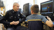 Police officers mentoring children at Middle River school