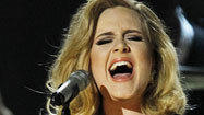 As Whitney Houston's death casts shadow, Adele sweeps the awards