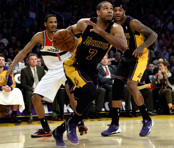 Xavier Henry gets by Washington's Trevor Ariza as Lakers teammate Jordan Hill looks on Friday night at Staples Center.