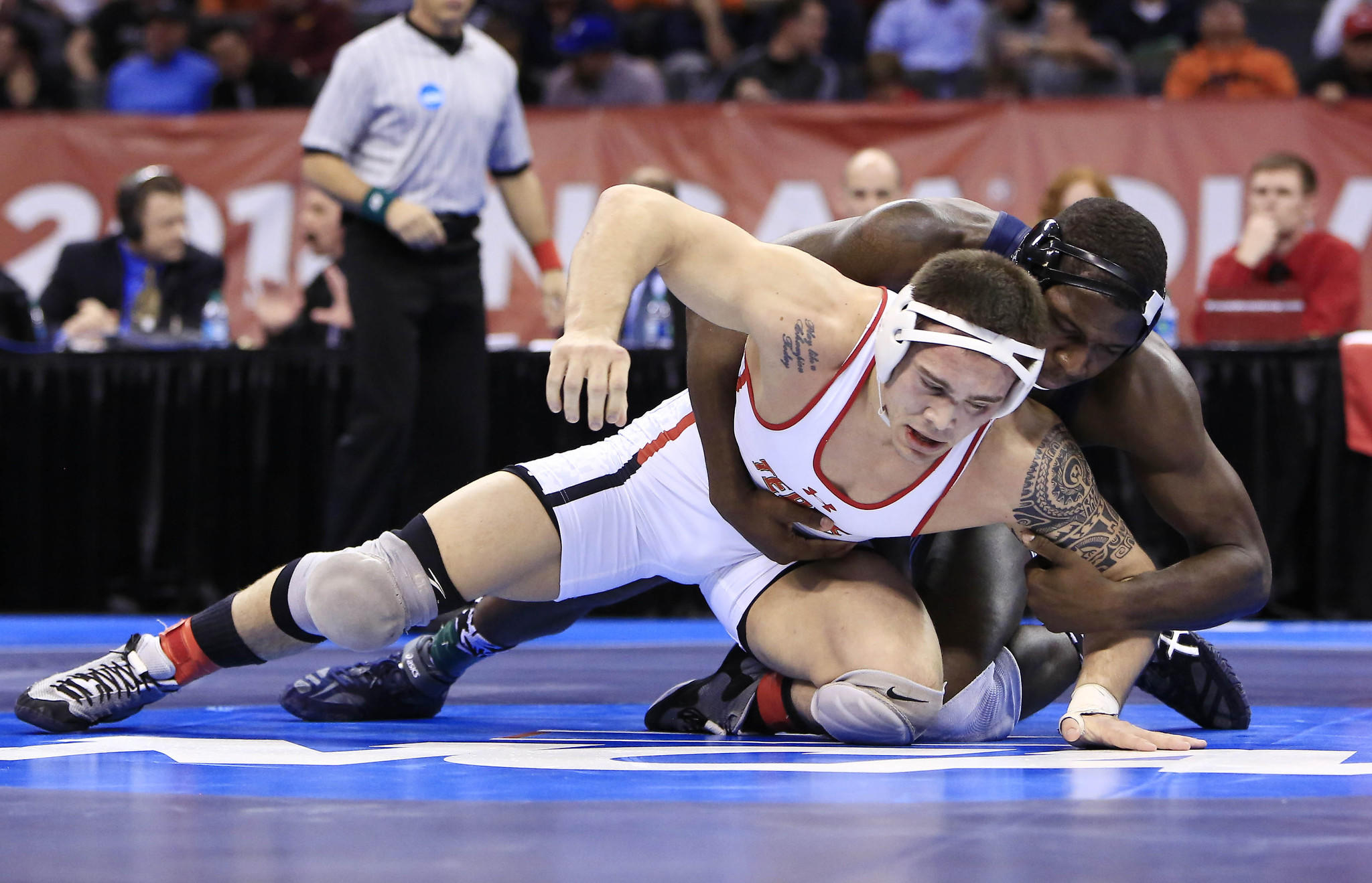 Penn State's Edward Ruth grapples with Maryland's Jimmy Sheptock in the 184-pound final. Ruth won the title, handing Sheptock his first defeat of the season.
