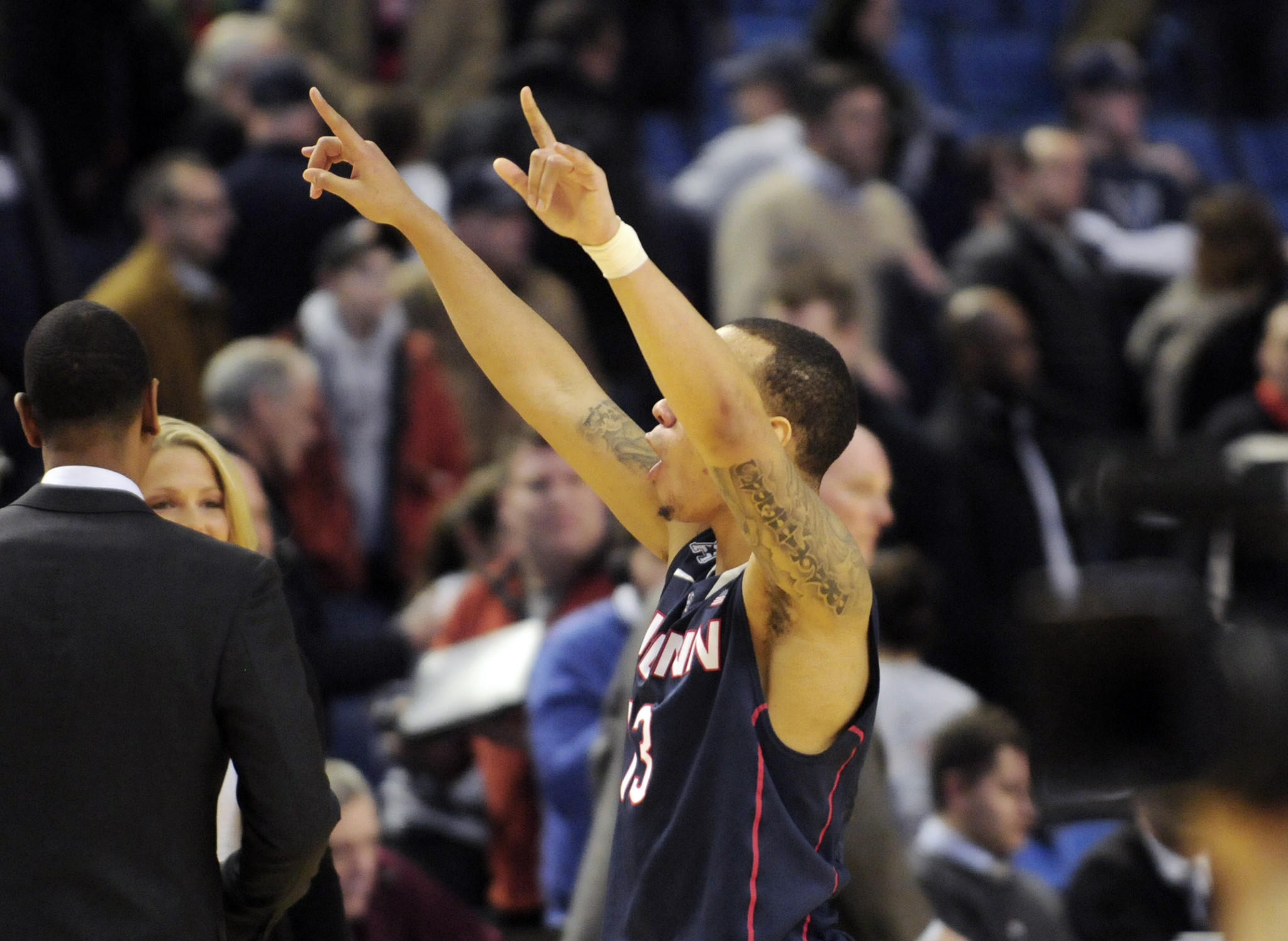 Shabazz Napier signals his fans at the end of the game. UConn met their old Big East rival. Villanova in the 3rd round of the NCAA tournament Saturday night at the First Niagara Center and won, 77-65 and will continue to the Sweet-16.