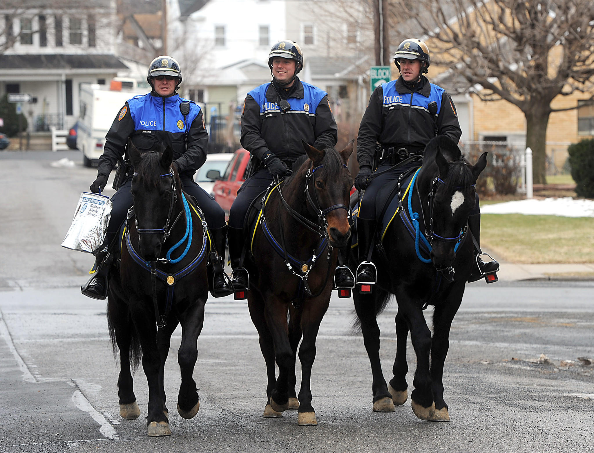 Bethlehem mounted police officers (from left) Tim Brooks, Jon Buskirk and Michael Leaser are among the {lsquo}community champions' delivering Meals on Wheels.