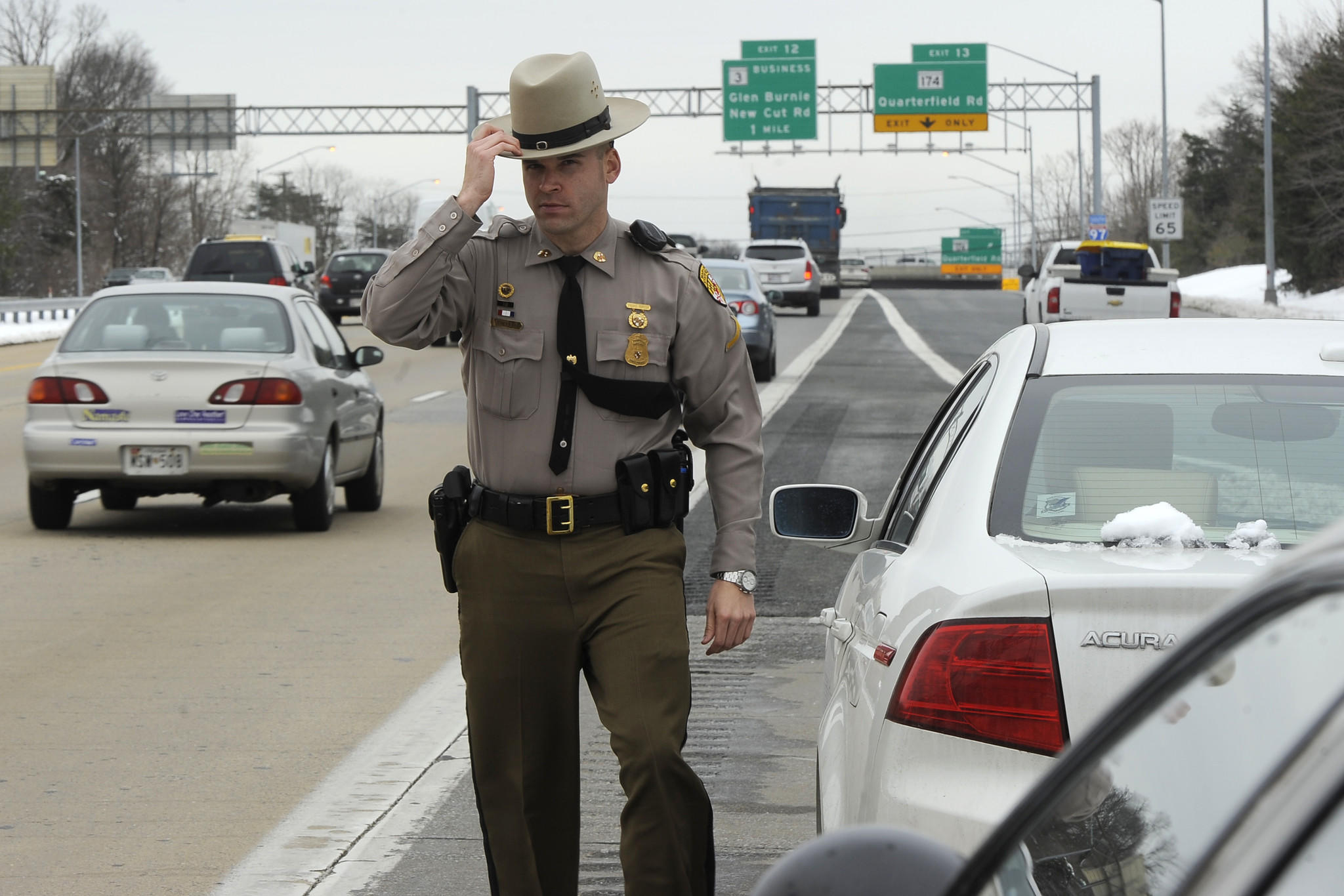 "Maryland State Trooper First Class Thomas Thelen walks to his car after speaking to a motorist he pulled over on Route 97 southbound. The driver failed to obey the ""Move Over"" law."