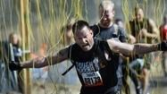 Athletes get down and dirty in obstacle mud runs