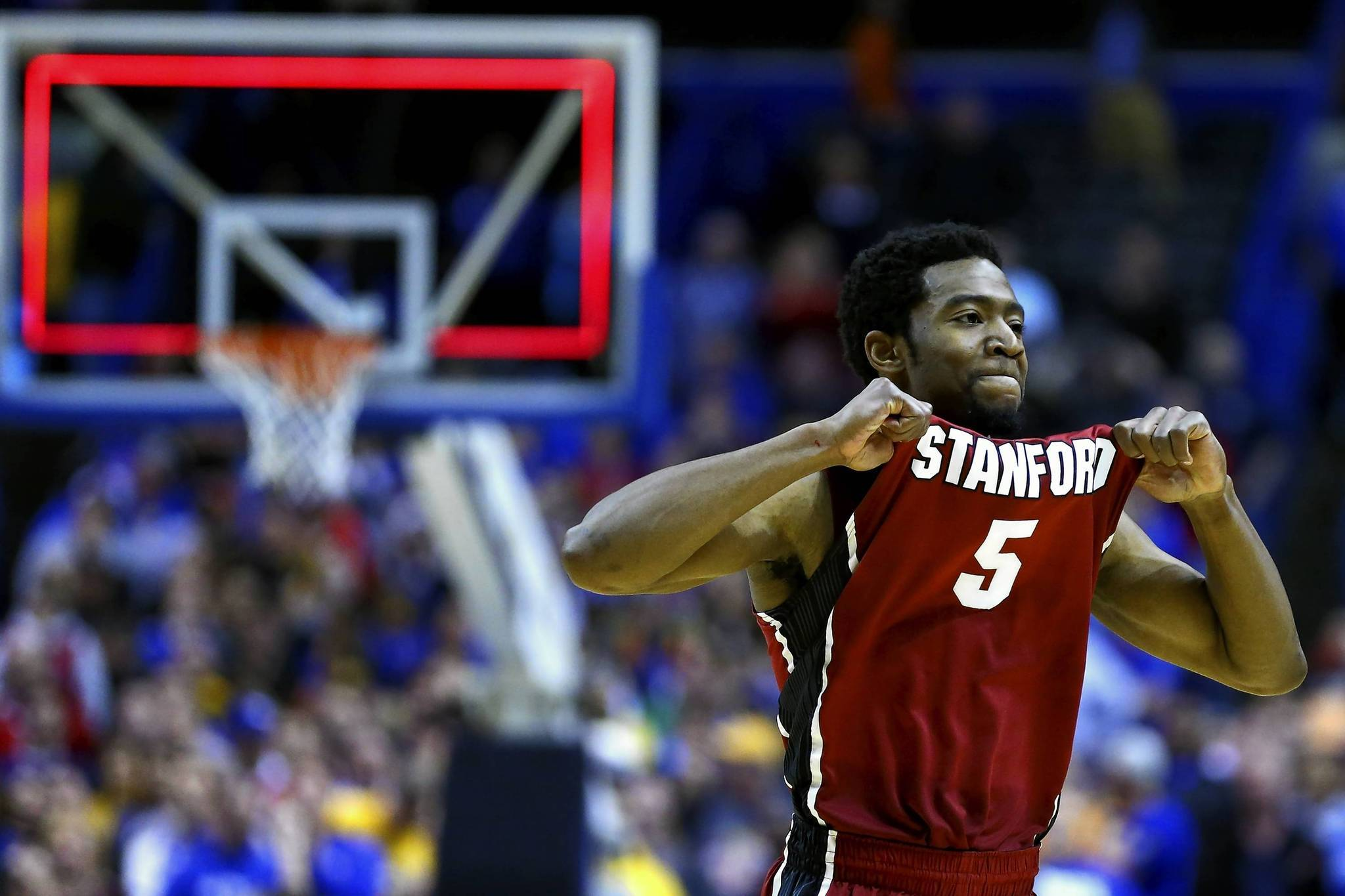 Chasson Randle of Stanford celebrates after defeating Kansas.