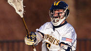 For boys lacrosse players, the recruiting process is starting earlier than ever