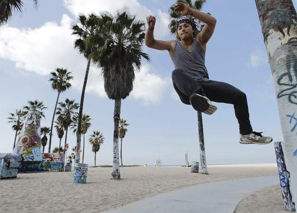"""Michael """"Frosti"""" Zernow, a parkour athlete and instructor, demonstrates the tic tac at Venice Beach."""