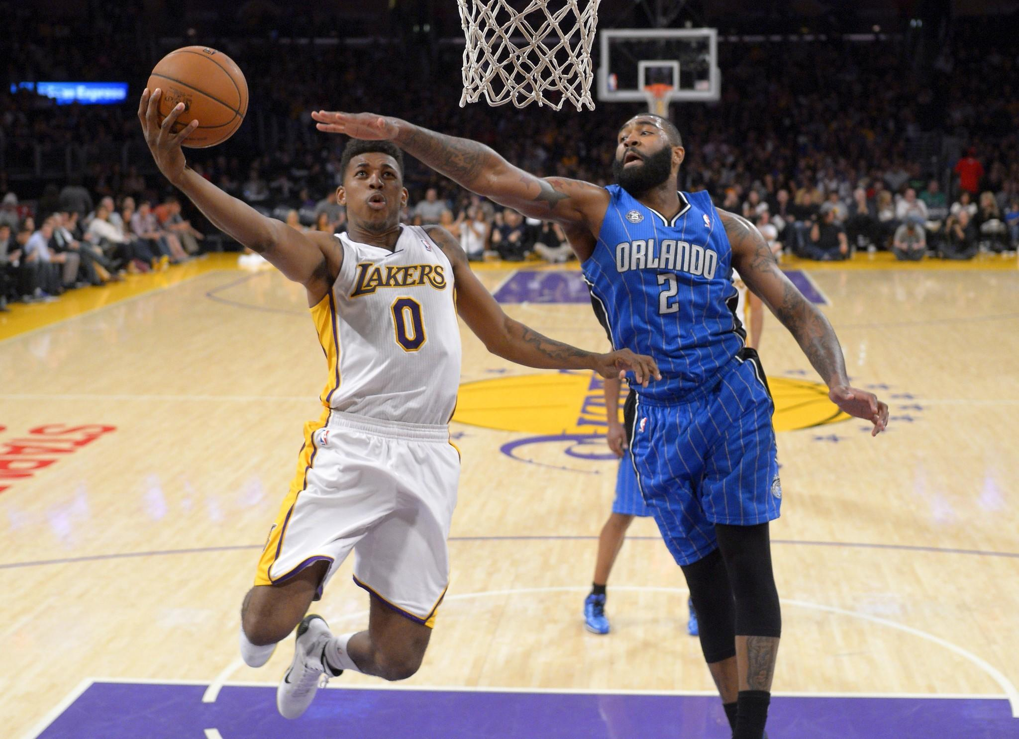 Lakers forward Nick Young has his layup challenged by Magic forward Kyle O'Quinn in the second half.