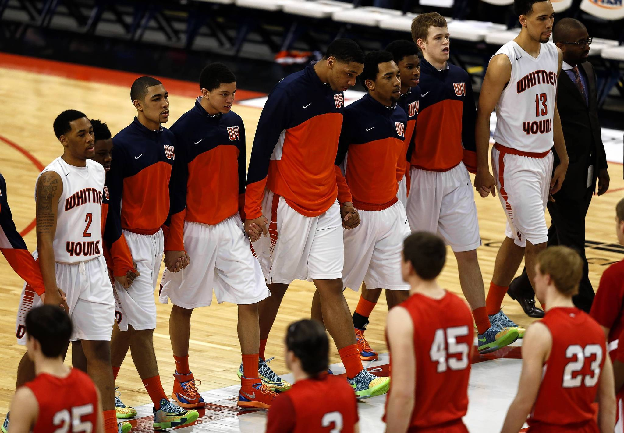 Whitney Young's Jahlil Okafor and his teammates walk hand in hand to shake with Benet before the state final.