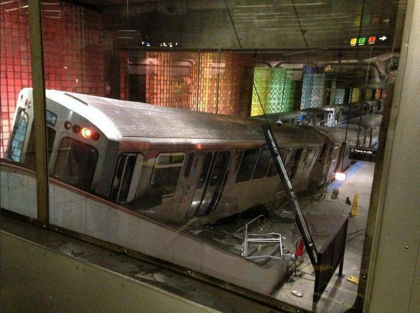 A Blue Line train sits at the bottom of an escalator at O'Hare International Airport after it derailed and overran the platform this morning.