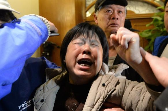 Relatives of  passengers on Malaysia Airlines Flight  370 weep after hearing the news that the plane plunged into the Indian Ocean.
