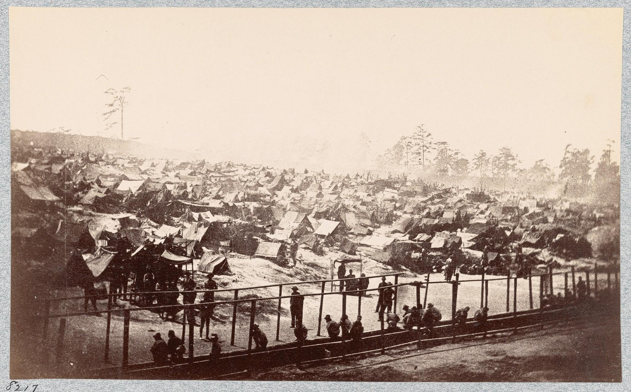 This view shows prisoners and the tents that served as their shelters at Andersonville prison.