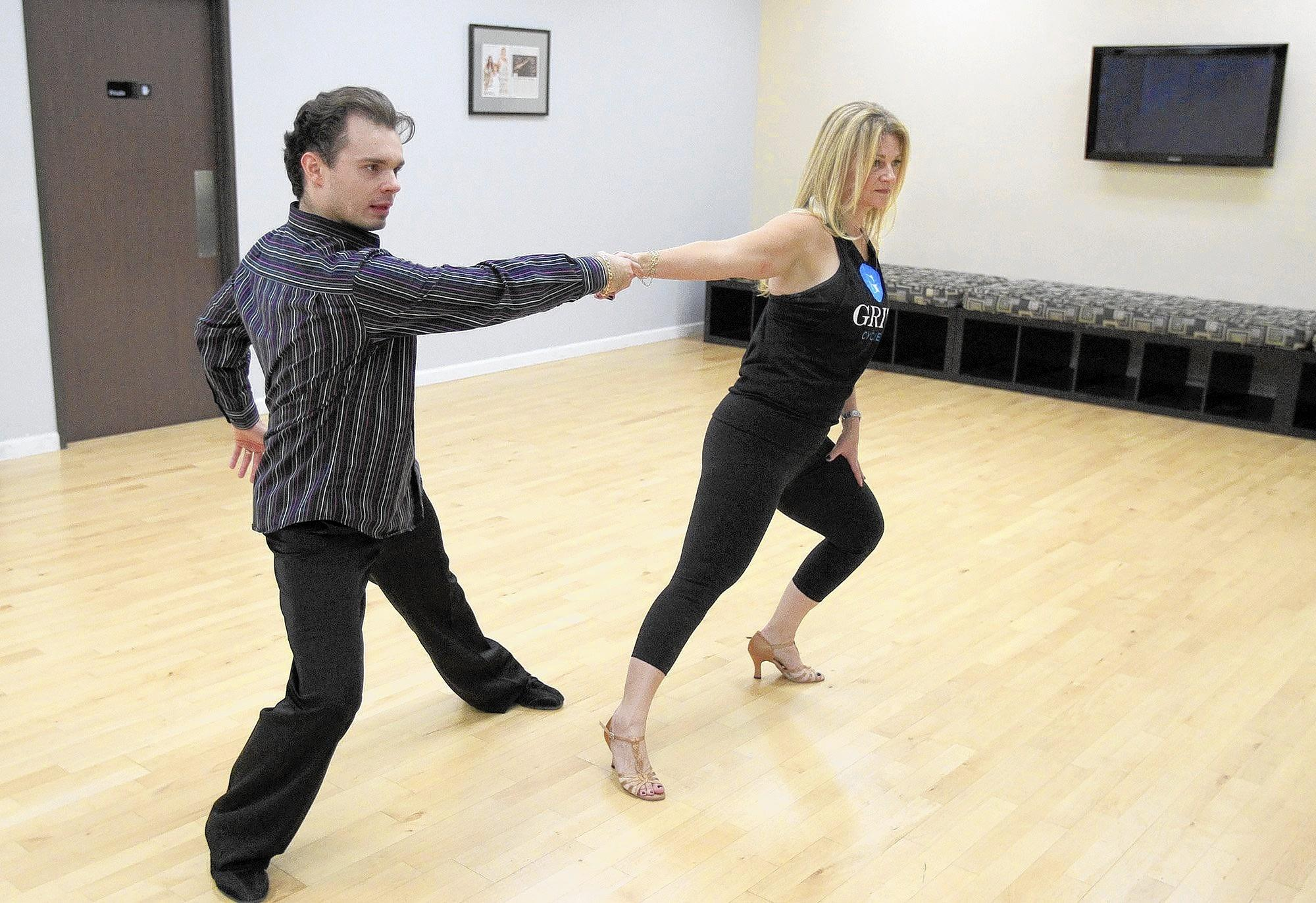 "Marisa Wayne of Newport Beach trains with dance partner Dawid Schulz at Century Dancesport in Tustin. Wayne is a celebrity featured in the upcoming Assistance League of Newport-Mesa's seventh annual ""Dancing for Tomorrow's Stars"" fundraising gala at the Grove of Anaheim on Saturday. She is the daughter of John Wayne."