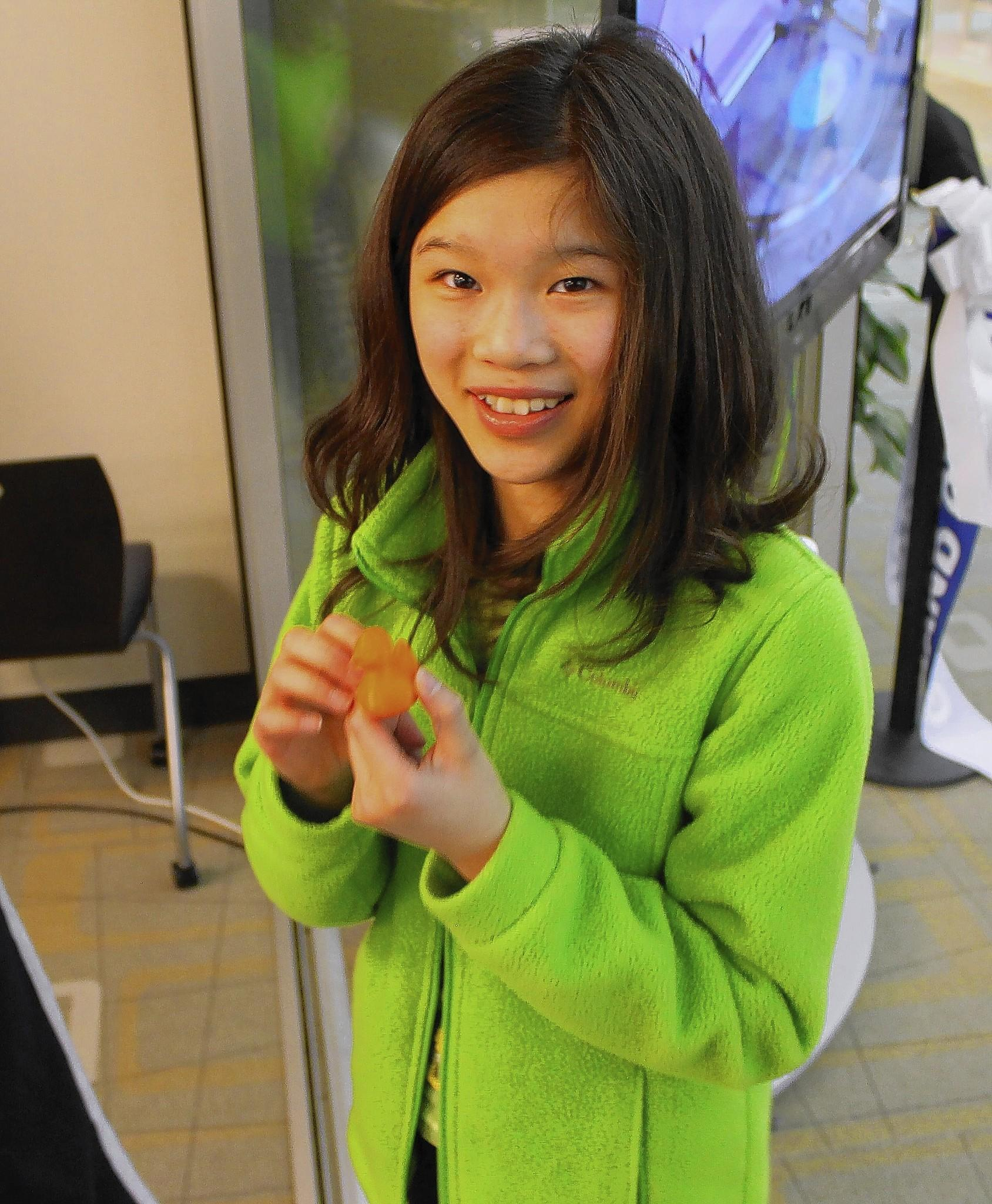 """It's pretty cool, all this neat stuff,"" said Elizabeth Hung, 11, holding an object fabricated by a 3-D printer at the new Idea Lab at the 95th Street Library."